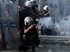 Turkish riot police fire tear gas at demonstrators during clashes in Istanbul's Taksim square on June 11, 2013. Turkish Prime Minister Recep Tayyip Erdogan on June 11 said three protesters and one police officer have been killed in nearly two weeks of nationwide unrest against his Islamic-rooted government.   AFP PHOTO / ARIS MESSINIS        (Photo credit should read ARIS MESSINIS/AFP/Getty Images)