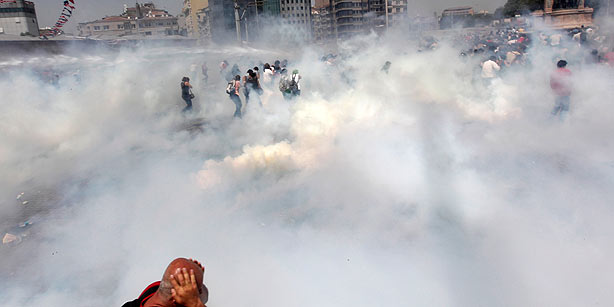 Riot police use tear gas to disperse the crowd during an anti-government protests at Taksim Square in central İstanbul on May 31, 2013. (Photo: Reuters, Osman Orsal)