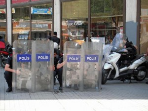Police hide behind their shields in Taksim