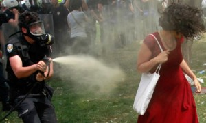 Turkish riot policeman uses tear gas against