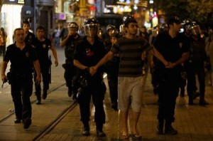 Riot police detain an anti-government protester at Istiklal Street in central Istanbul July 13, 2013. REUTERS/Umit Bektas