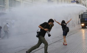 Riot police use water cannon to disperse demonstrators during a protest in central Istanbul