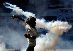 man-throwing-tear-gas_68351_600x450