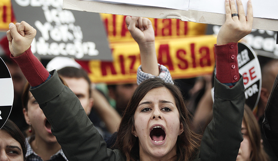 University students shout anti-government slogans during a protest against Turkey's High Education Board in Istanbul