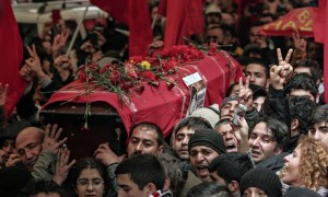 The coffin of Berkin Elvan is carried through Istanbul. He died in hospital today, nine months after being hit by a police teargas cartridge. Photograph: Emrah Gurel/AP