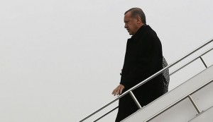 Turkey's Prime Minister Erdogan steps off from his plane as he arrives in Elazig for an election rally of his ruling AK Party