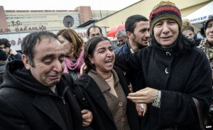 Berkin Elvan's mother (C) was surrounded by mourners outside the hospital on Tuesday