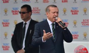 'We'll eradicate Twitter. I don't care what the international community says,' Turkish PM Erdoğan said at his campaign rally in Bursa. DHA Photo