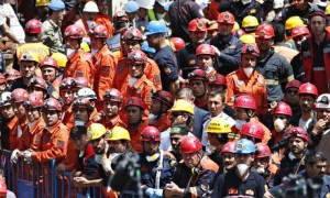 Miners and rescue workers await the arrival of Turkey's president, Abdullah Gül, outside the mine in Soma. Photograph: Lefteris Pitarakis/AP