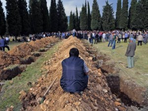Rows of open graves for the mine accident victims are seen in Soma, Turkey (AP)