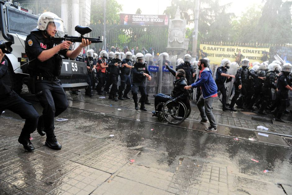 Riot police fire plastic paintball gun pellets to disperse protesters in central Istanbul during a demonstration blaming the ruling AK Party (AKP) government for the mining disaster